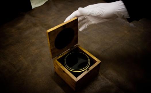 Photograph: Marcos Avlonitis. Object: Science Museum, Pocket Horizon.Gloved hand: Kelley Swain's.